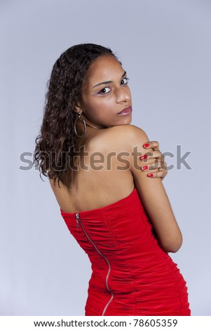 Beautiful african looking back  (isolated on gray) - stock photo