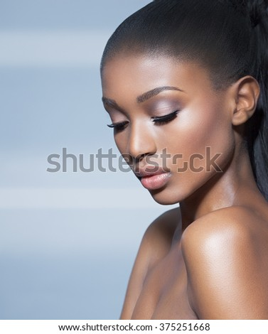 Beautiful African model over blue background. Fashion and beauty with African dark skin model. - stock photo