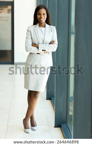 beautiful african office worker with arms crossed - stock photo