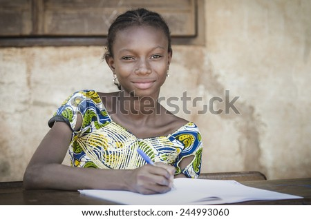 Beautiful African Teenage Schoolgirl Smiling At Public School - stock photo