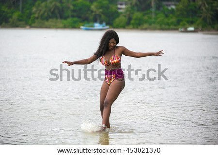 Beautiful African woman at the beach on summer holidays.