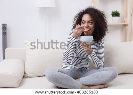 Beautiful african woman is enjoying healthy food - stock photo