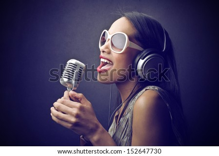beautiful African woman singing with the microphone - stock photo