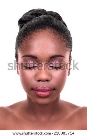 Beautiful African woman with fresh clear skin and everyday natural face makeup on white. Skin care and spa. Wearing eye shadow and pink lipstick or lip gloss. Fashion hairstyle updo. - stock photo