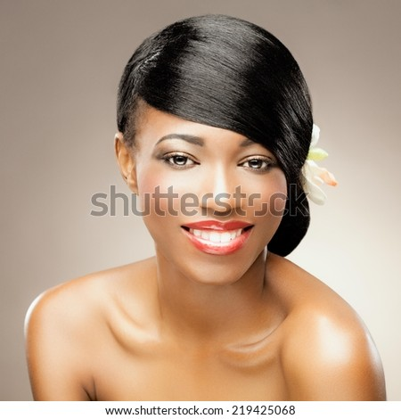 Beautiful african woman with healthy silky hair smiling. - stock photo