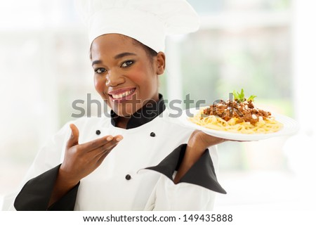 beautiful afro american chef presenting spaghetti - stock photo
