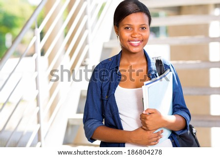 beautiful afro american college student with books - stock photo