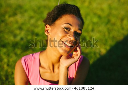 Beautiful afro american woman posing at camera outdoors