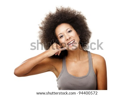 Beautiful Afro-American woman showing the call sign, isolated on white