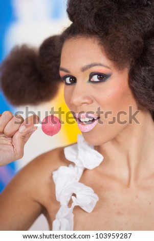 Beautiful afro-american woman with lollipop