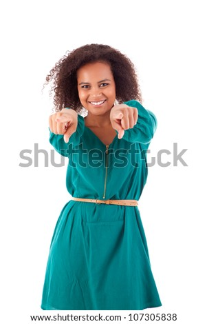 Beautiful afro woman pointing to the front - stock photo