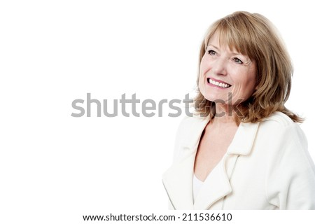 Beautiful aged woman smiling and looking up