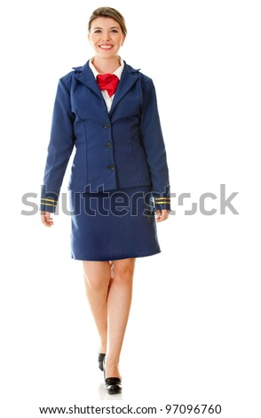 Beautiful air hostess walking - isolated over a white background