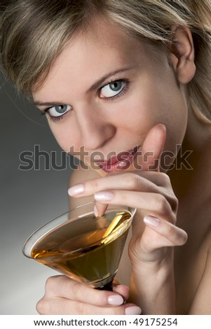 Beautiful alluring woman with glass of cocktail