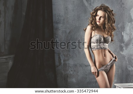 Beautiful alluring young woman in sexy lingerie. - stock photo