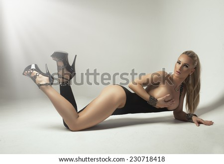 Beautiful alluring young woman in sexy wear  - stock photo