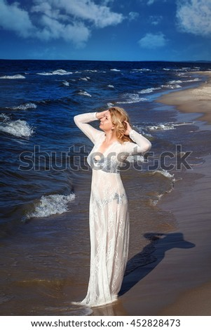 beautiful alone girl on the beach