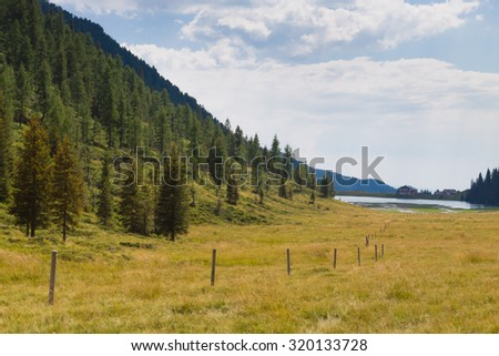 Beautiful alpine panorama, group Pala of dolomites from Calaita lake, Italian landscape - stock photo