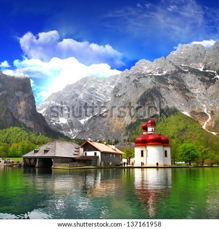 beautiful Alpine scenery - crystal lake Koenigsee  with small church - stock photo