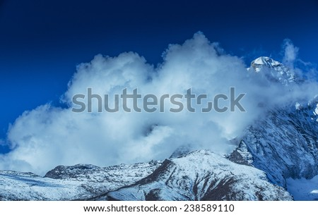 Beautiful alpine scenery in the Himalayas, with snow capped mountains - stock photo