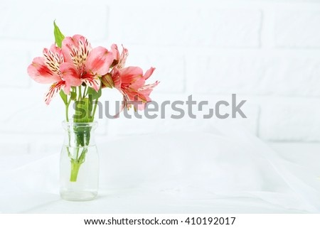 Beautiful alstroemeria flowers on a white wooden table