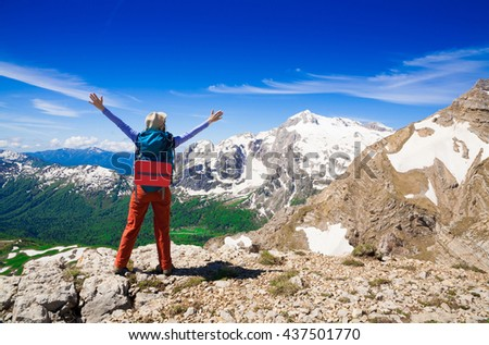 Beautiful amazing day summer mountains. A woman goes a sport hike in holidays. Nature background. Northern country Russia Caucasus wilderness. Rocky route. Blue sky. Inspiring leisure. - stock photo