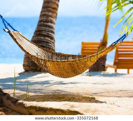 Beautiful amazing nature background. Tropical blue sun sea. Luxury holiday resort. Island atoll about coral reef. Fresh  freedom. Adventure day. Coconut paradise. Hammock and sunbed. - stock photo