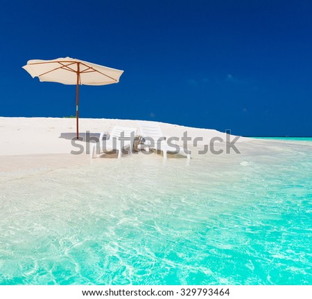 Beautiful amazing nature background. White sunbed longue and parasol in tropical blue sun sea. Luxury holiday resort. Island atoll about coral reef. Fresh  freedom. Adventure day. Snorkeling.  - stock photo