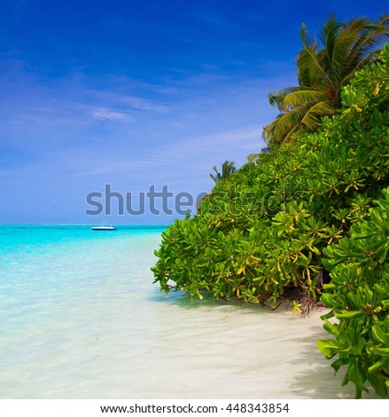 Beautiful amazing nature background with the boat. Tropical blue sun sea in Maldives. Luxury holiday resort.  - stock photo
