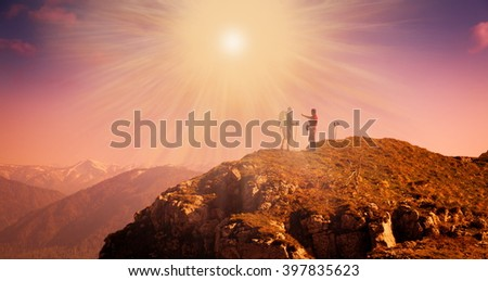 Beautiful amazing sunset autumn mountains. A man goes a sport hike in holidays. Nature background. Unique landscape. Northern country Russia Caucasus. Go to the aim.