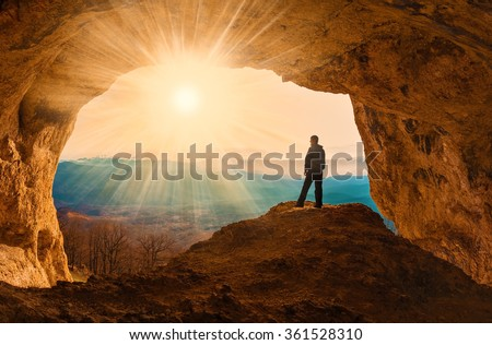 Beautiful amazing sunset.  Mountains in north country Russia Caucasus. Unique landscape mainsail.  Silhouette of a man. Old cave. Active sport and hobby. Spelunking background. Quest - stock photo