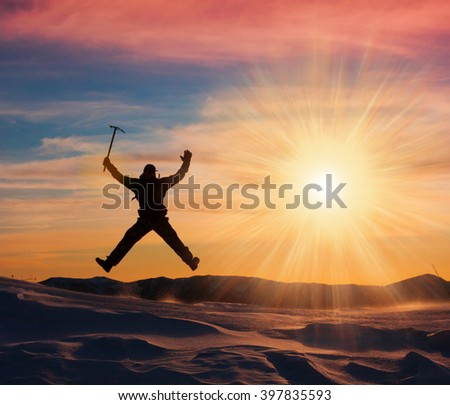 Beautiful amazing sunset winter mountains. A man goes a sport hike in snow holidays. Nature background. Unique landscape. Northern country Russia Caucasus. Go to the aim.