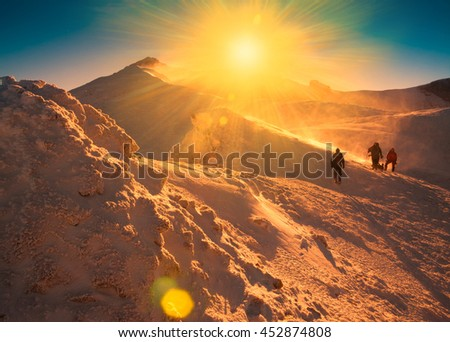 Man Beautiful Mountain Day Winter Landscape Stock Photo - This man hikes up the transylvanian mountains every morning to photograph sunrise