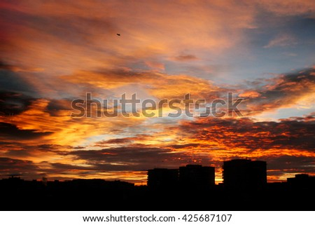 beautiful amazing view at sun rising over city buildings in summer