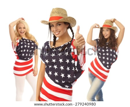Beautiful American girls posing in American flag t-shirt, smiling. - stock photo