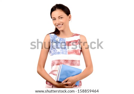 Beautiful American student with USA flag on her blouse holding books. Learn English. Isolated on white. - stock photo