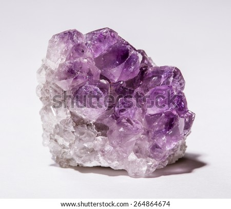 Beautiful amethyst stone on white background - stock photo
