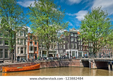 Beautiful Amsterdam canals with typical houses - stock photo