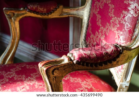 Beautiful ancient antique chair in red and white colors. - stock photo