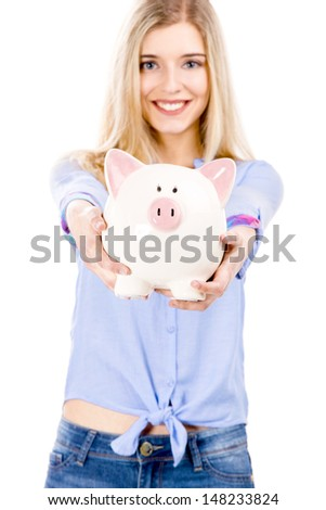 Beautiful and attractive blonde woman holding and showing a piggy bank, isolated over white background - stock photo