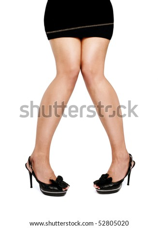 Beautiful and attractive caucasian female legs isolated on white background