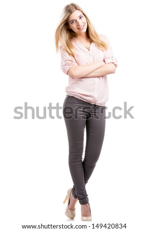 Beautiful and attractive fashion woman smiling and posing, isolated over white background - stock photo