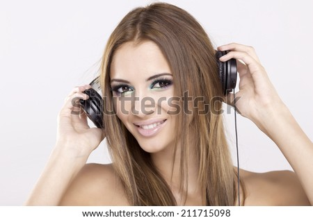 Beautiful and attractive young adult sensuality brunette girl is listen to the music