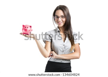 Beautiful and attractive young business woman smiling holding a piggy bank, isolated on white - stock photo