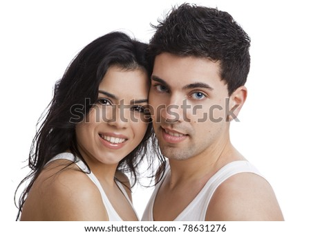 Beautiful and attractive young couple standing over a white background