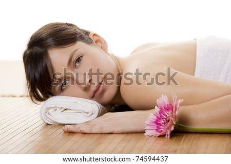 Beautiful and attractive young woman getting a spa treatment