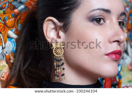 Beautiful and charming brunette in a Sicilian style.jewelry inspired by the Sicilian cart