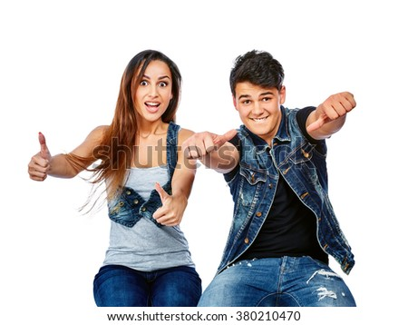 Beautiful and cheerful couple showing thumbs up. Isolated on a white background - stock photo