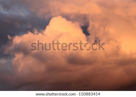 Beautiful and colorful big clouds by sunset - stock photo