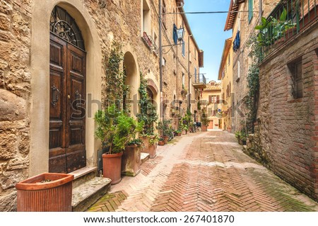 Beautiful and colorful streets of the small and historic Tuscan village Pienza, Italy - stock photo